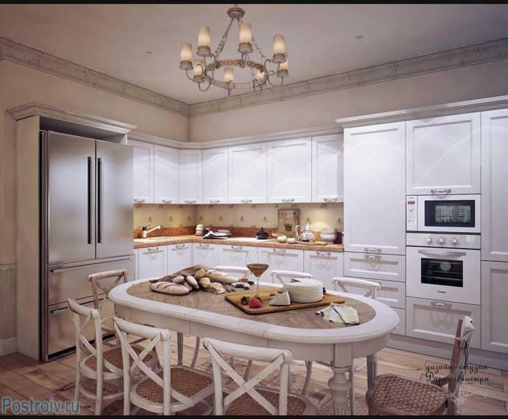 Большая угловая белая кухня с овальным столо